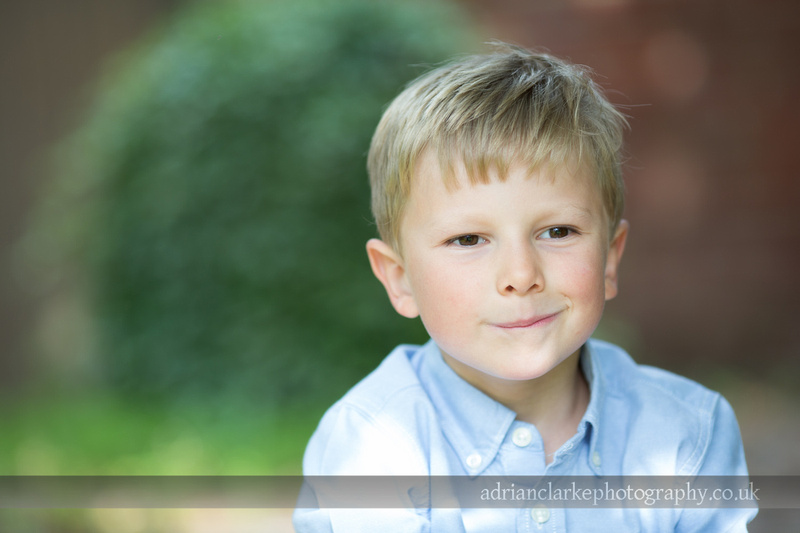photograph of young boy in sunny garden, kent
