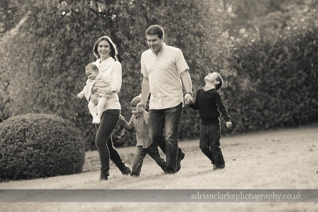 photograph of family walking in garden sevenoaks