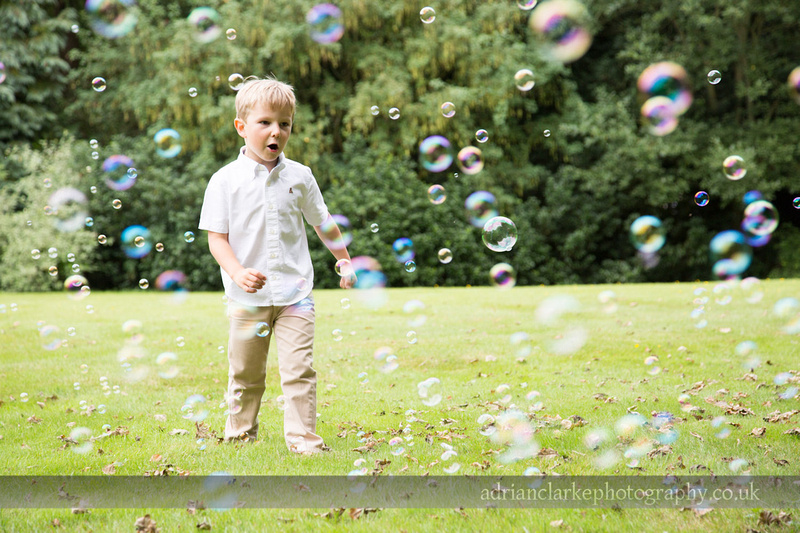portrait of young boy with bubble machine