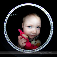 Quirky portrait photograph of girl and toy