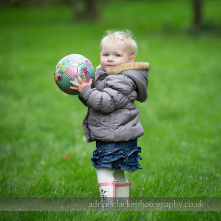 Photograph of young girl holding football, Brasted, Sevenoaks