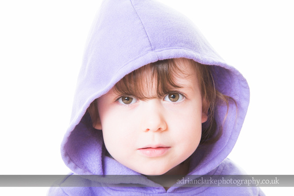 Portrait photograph of young girl wearing a hood, Brasted, Sevenoaks