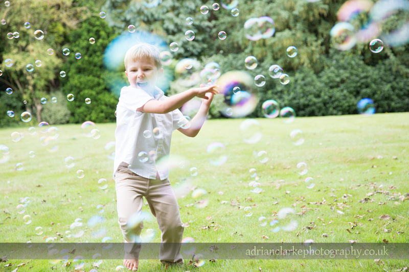 photograph of boy with bubbles
